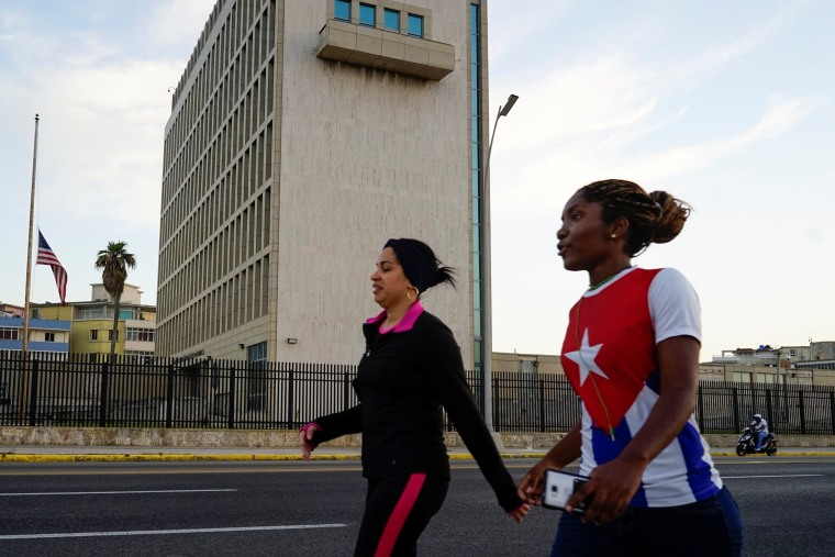 Image: People walk past the U.S. Embassy in Havana