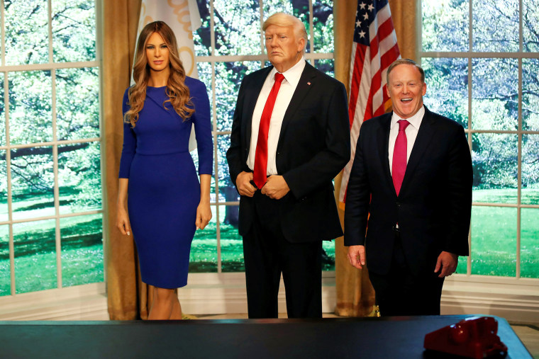 Image: Former White House Press Secretary Sean Spicer poses next to a newly unveiled wax figure of first lady Melania Trump standing next to a wax figure of her husband, U.S. President Donald Trump, at the Madame Tussauds in New York City