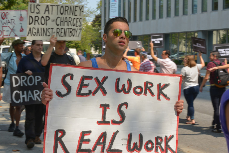 Image: A demonstrator protests the shutdown of Rentboy.com.