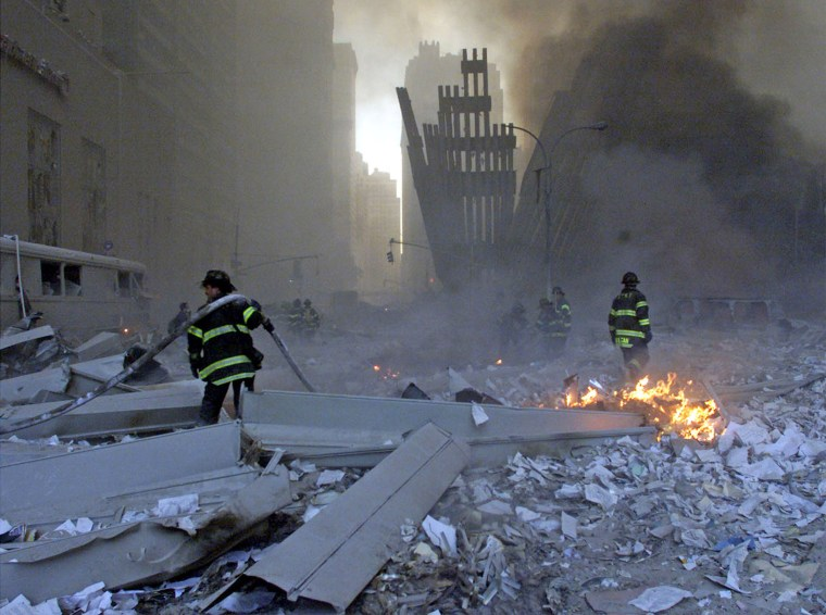 Image: File picture shows firemen working around the World Trade Center after both towers collapsed in New York