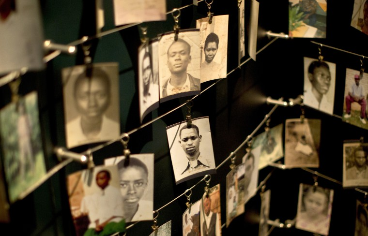 Image: Family photographs of some of those who died hang in a display in the Kigali Genocide Memorial Centre in Kigali, Rwanda on April 5, 2014.