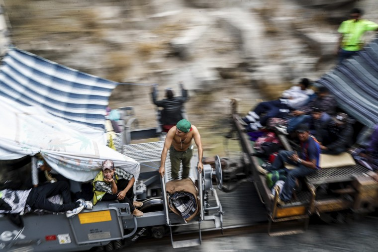 "Image: Central American migrants ride a north-bound train known as ""La Bestia"""