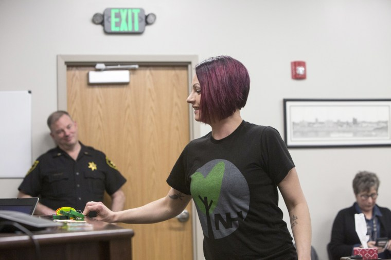 Image: Carly collects a reward for good behavior at the Cabell County Drug Court, April. 9, 2018, in Huntington, West Virginia.