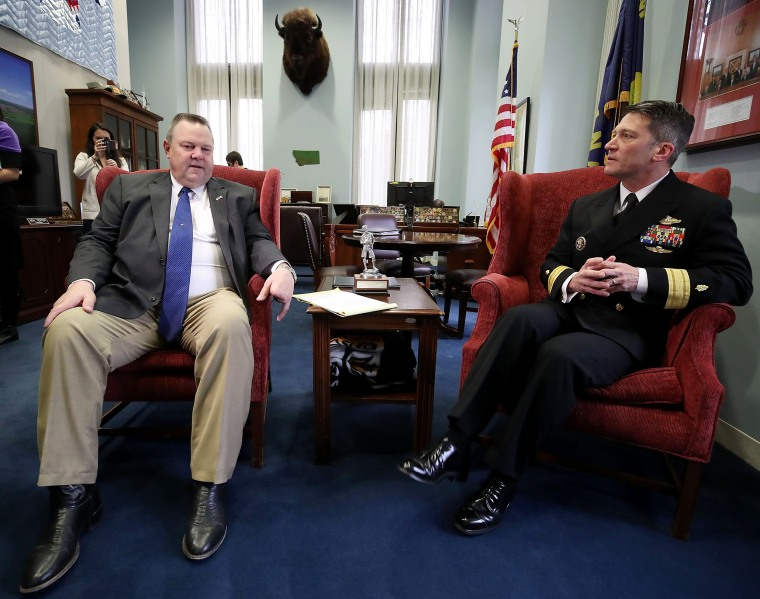 Image: Physician to the President U.S. Navy Rear Admiral Ronny Jackson meets with Sen. Jon Tester in his office in the Hart Senate Office Building on Capitol Hill on April 16, 2018 in Washington, DC.