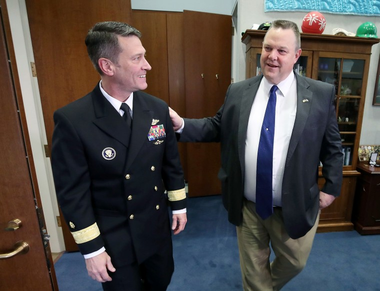 Image: Physician to the President U.S. Navy Rear Admiral Ronny Jackson meets with Sen. Jon Tester in his office in the Hart Senate Office Building on Capitol Hill on April 17, 2018 in Washington, DC.