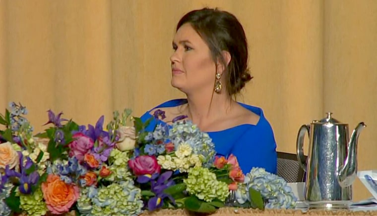 Image: White House Press Secretary Sarah Huckabee Sanders reacts to Comedian Michelle Wolf's jokes about her at the White House Correspondents' Dinner in Washington, DC, April 28, 2018.
