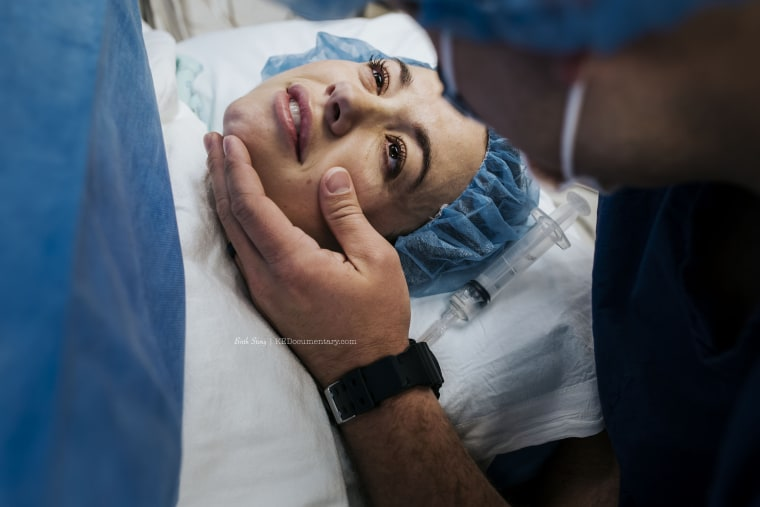 Scholz captured this touching image during Adria Church's C-section.