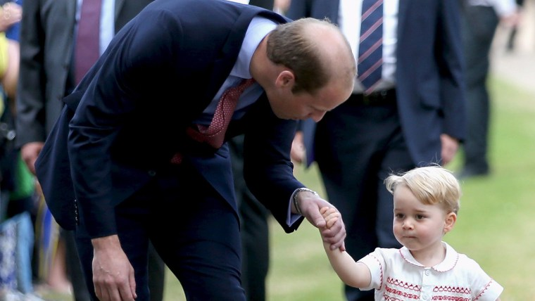 Image: Prince William, Duke of Cambridge speaks with Prince George of Cambridge as they arrive at the Church of St Mary Magdalene on the Sandringham Estate for the Christening of Princess Charlotte of Cambridge