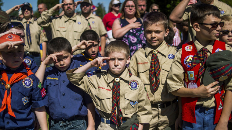Boy Scouts and Cub Scouts salute during a Memorial Day ceremony in Linden, Mich. On Wednesday, Oct. 11, 2017, the Boy Scouts of America Board of Directors unanimously approved to welcome girls