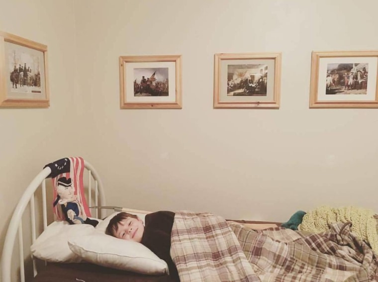 Oliver's bedroom, decorated with framed battlefield maps, Benjamin Franklin quotes, and the Declaration of Independence.