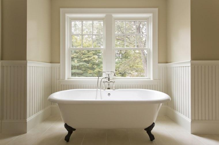 Clawfoot bathtub in custom designed bathroom.