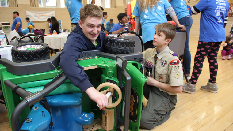 Local businesses and scout groups volunteer to re-fit Power Wheels cars to help children with disabilities have a toy of their own that also helps them be independent.