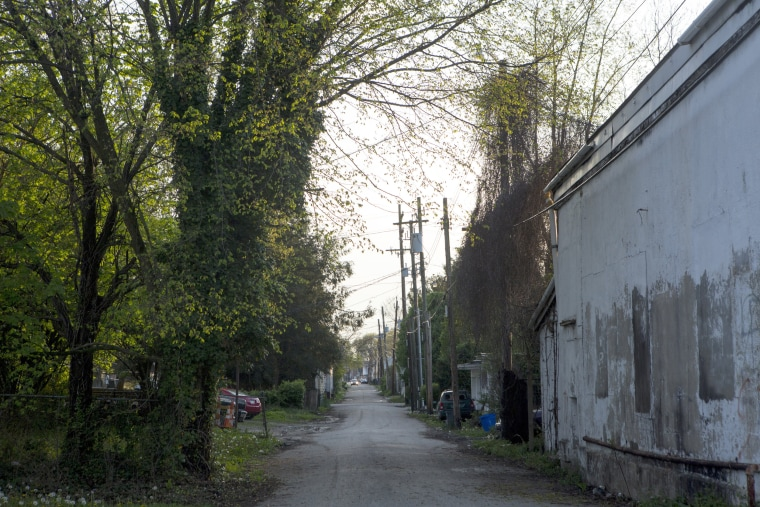 Image: A car drives down a alley near an area known for prostitution, April. 26, 2018, in Huntington, West Virginia.