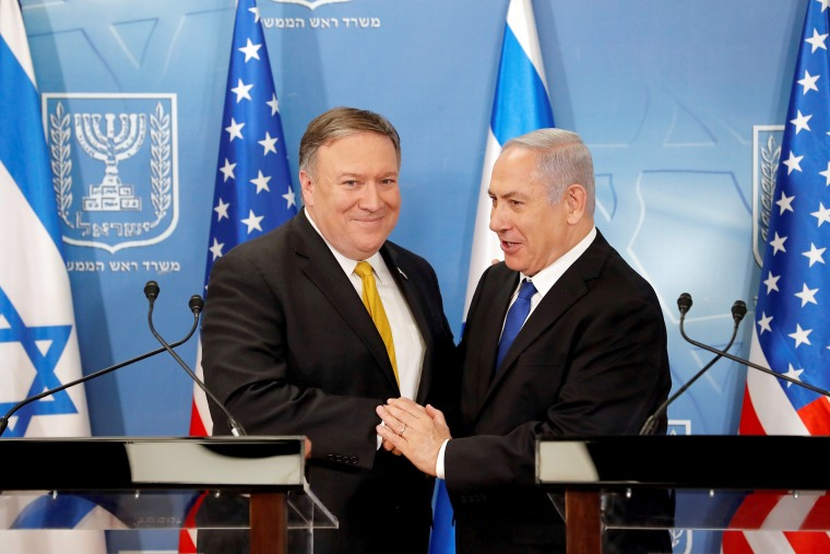 Image: Israeli Prime Minister Benjamin Netanyahu shakes hands with U.S. Secretary of State Mike Pompeo during a meeting at the Ministry of Defence in Tel Aviv