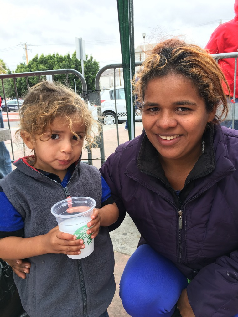 Image: Wendi Garcia and her son Oscar, migrants apart of the caravan waiting to seek asylum in the U.S., currently outside the San Ysidro port of entry.