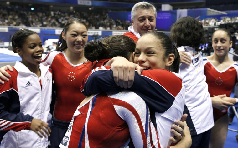 Image: USA's Sabrina Vega, center, celebrates with teammates after winning the women's team final at the Artistic Gymnastics World Championships