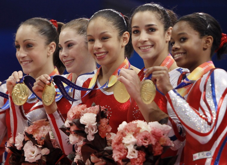 Image: USA's gymnasts, from left, Jordyn Wieber, McKayla Maroney, Sabrina Vega, Alexandra Raisman and Gabrielle Douglas, celebrate
