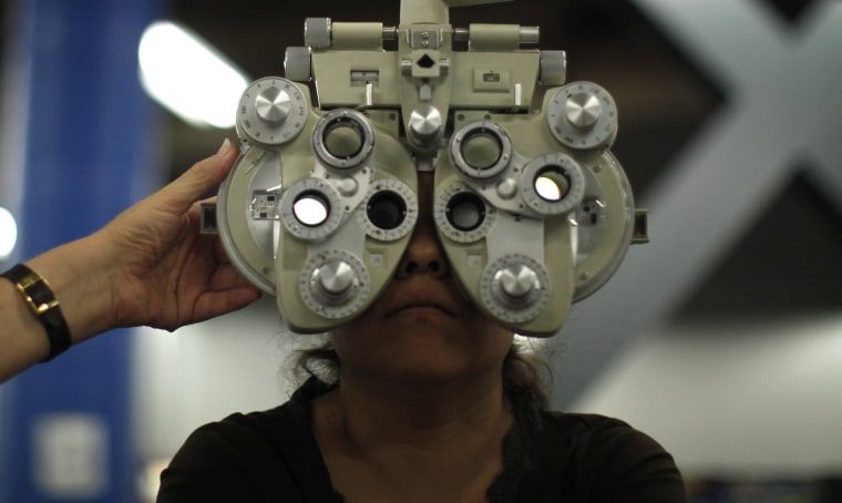 Image: A woman receives an eye exam