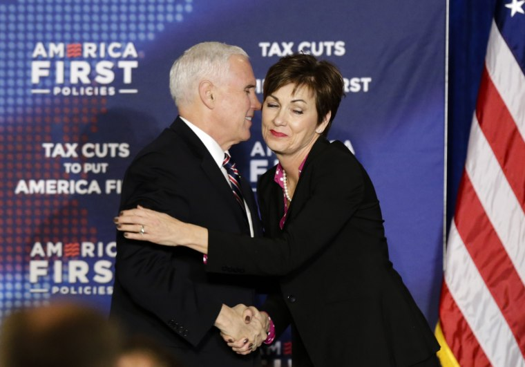Image: Iowa Gov. Kim Reynolds greets U.S. Vice President Mike Pence