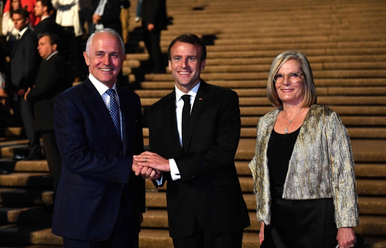 Image: France's President Emmanuel Macron with Australia's Prime Minister Malcolm Turnbull and his wife Lucy Turnbull