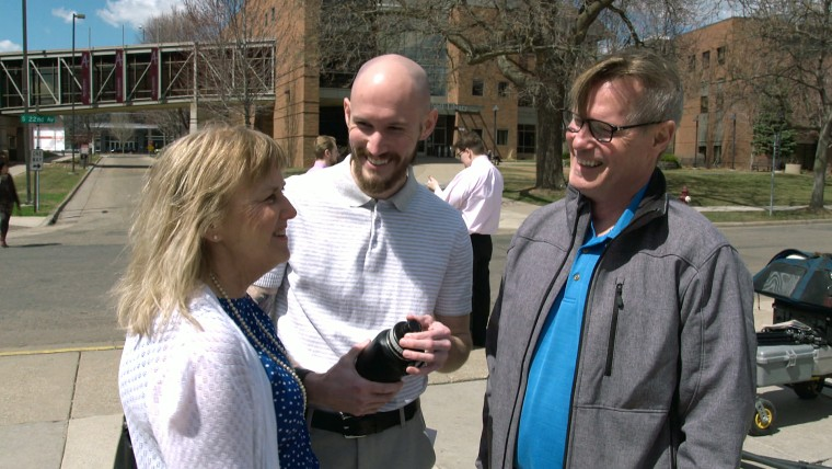 Image: Neil King speaks to his parents after his graduation at Augsburg University.