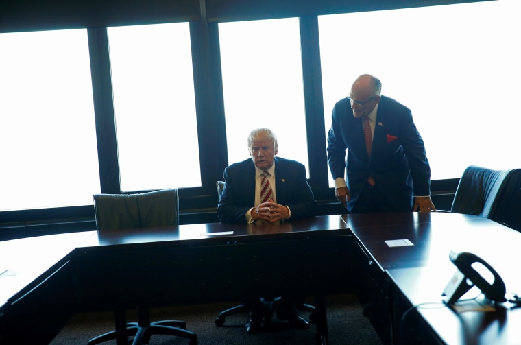 Image: Republican U.S. presidential nominee Donald Trump and former New York mayor Rudy Giuliani visit the Milwaukee County War Memorial Center in Milwaukee, Wisconsin, Aug. 16, 2016.