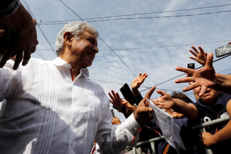 Image: Leftist front-runner Andres Manuel Lopez Obrador of the National Regeneration Movement (MORENA) greets supporters during his campaign rally in Mexico City