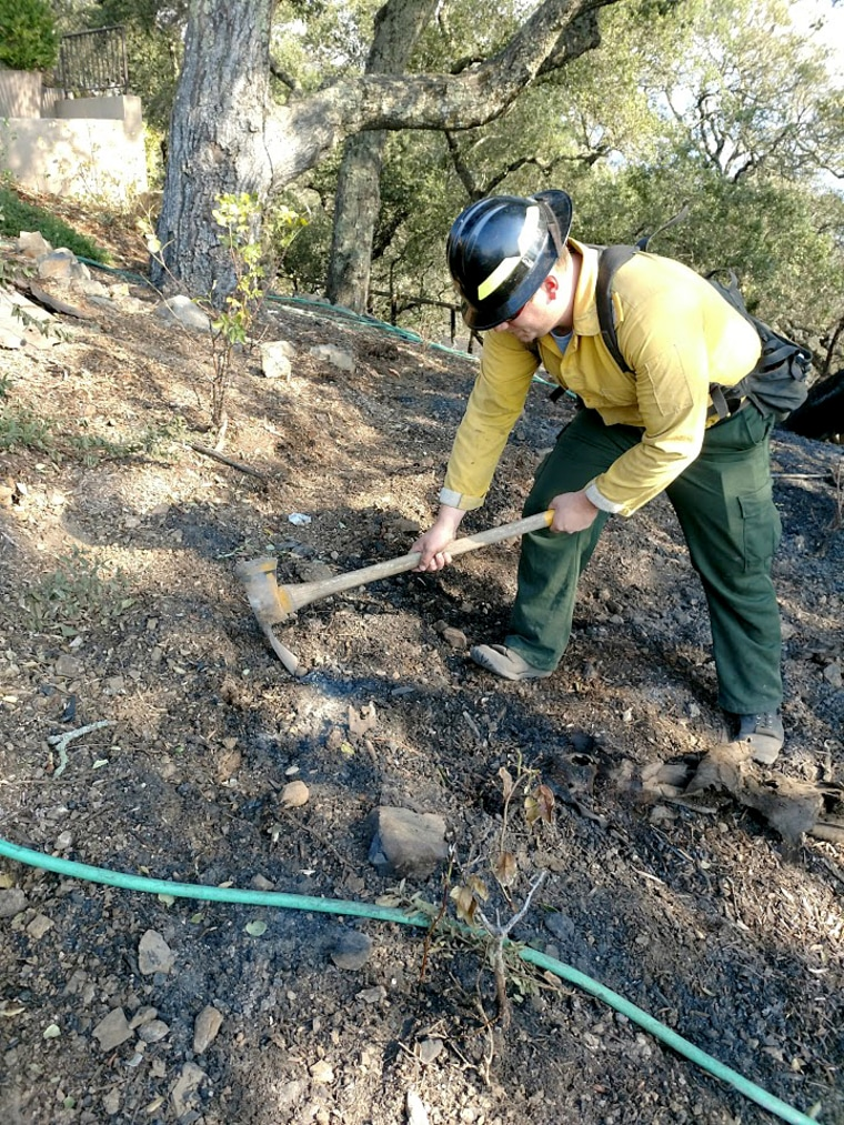 Image: Wildfire Defense Services firefighters dig up hotspots near the home of Fred Giuffrida and Pamela Joyner in Sonoma, California in Oct. 2017.