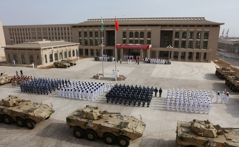 Image: Chinese People's Liberation Army personnel attend the opening ceremony of China's new military base in Djibouti