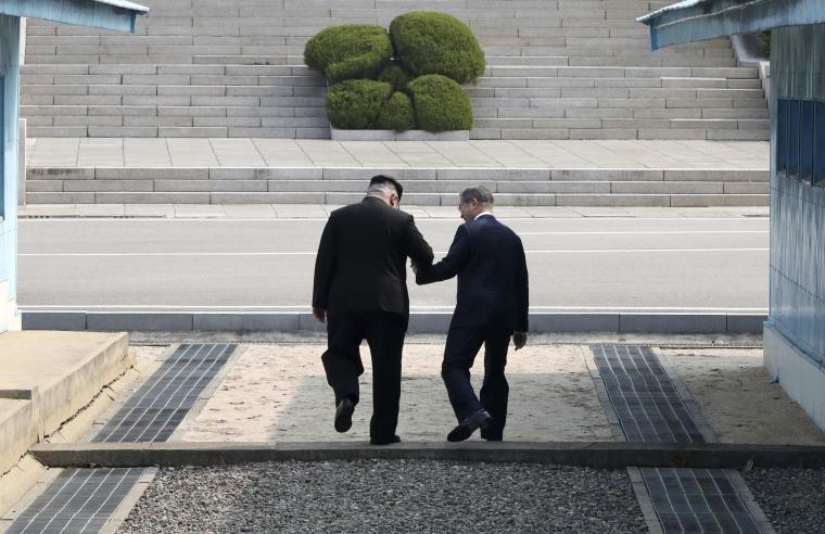 Image: North Korean leader Kim Jong Un walks with South Korean President Moon Jae-in