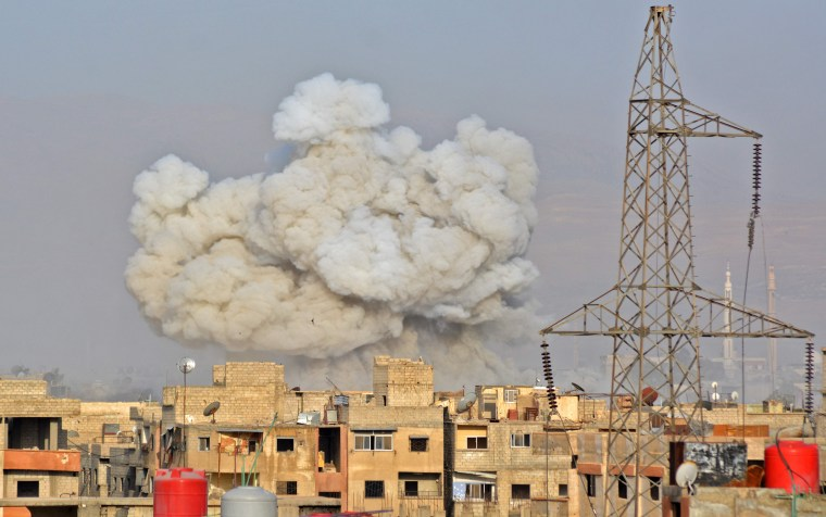 Image: Smoke rises from buildings during regime strikes in Damascus