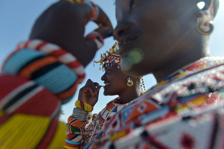 Image: Samburu women of the Lorubai traditional dance group participate in a peace marathon