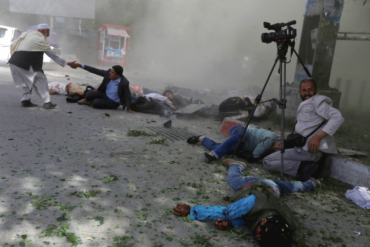 Image: Afghan journalists are impacted after a second blast in Kabul