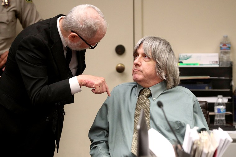 Image: David Allen Turpin talks with his attorney David Macher as he makes a court appearance in Riverside, California