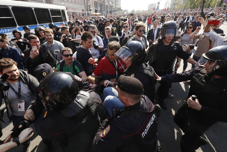 Image: Russian police arrest a protester at an opposition rally