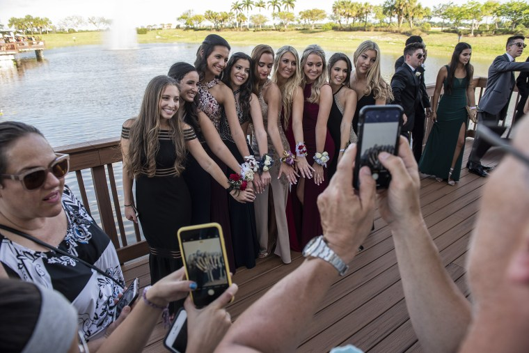 Image: Julia Cordover has her picture taken with classmates