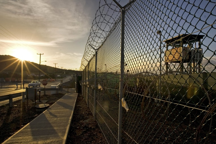 Image: The sun rises over Camp Delta detention compound at Guantanamo Bay