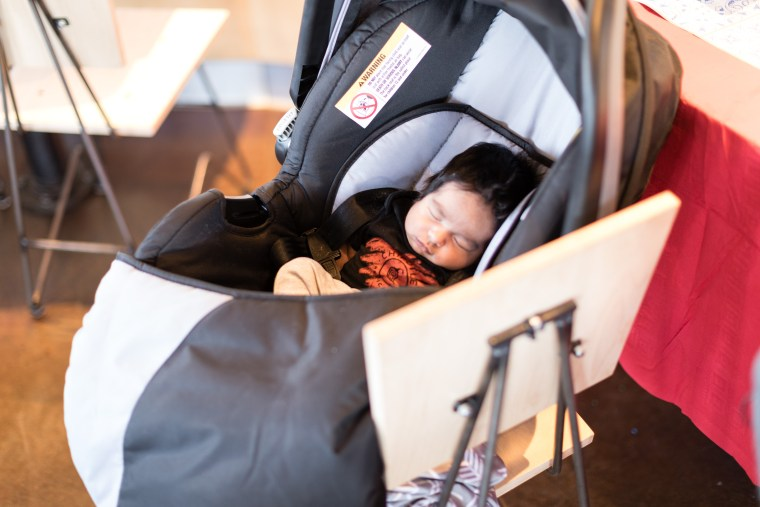 Baby Jaden, now four weeks old, sleeping at his Chipotle-themed baby shower.