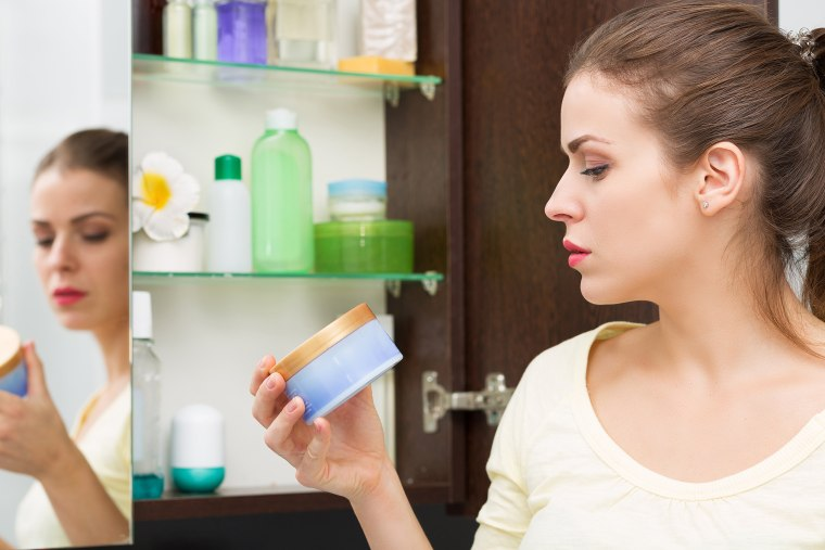 Woman looking at beauty products.