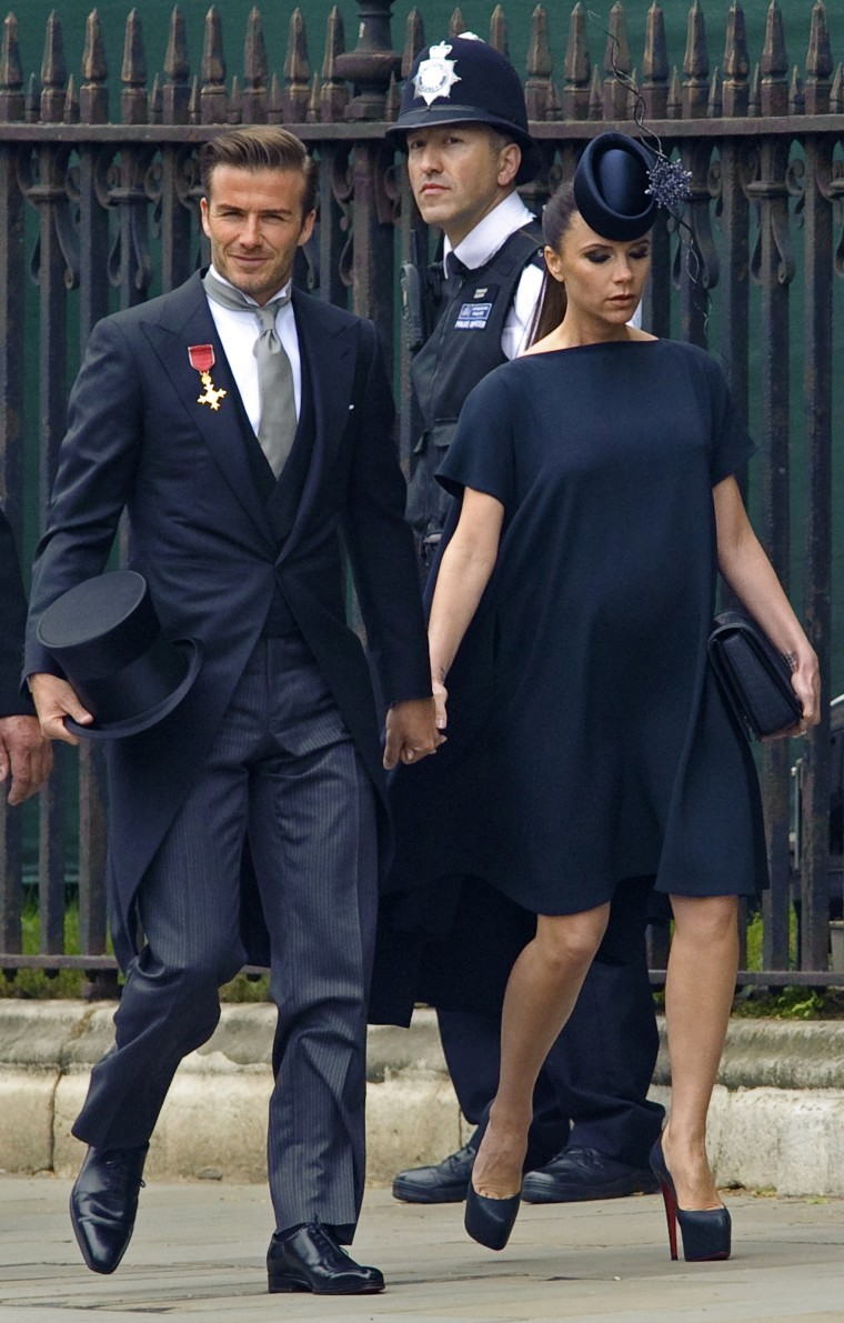 British soccer player David Beckham and his wife Victoria arrive at Westminster Abbey before the wedding of Britain's Prince William and Kate Middleton, in central London April 29, 2011.