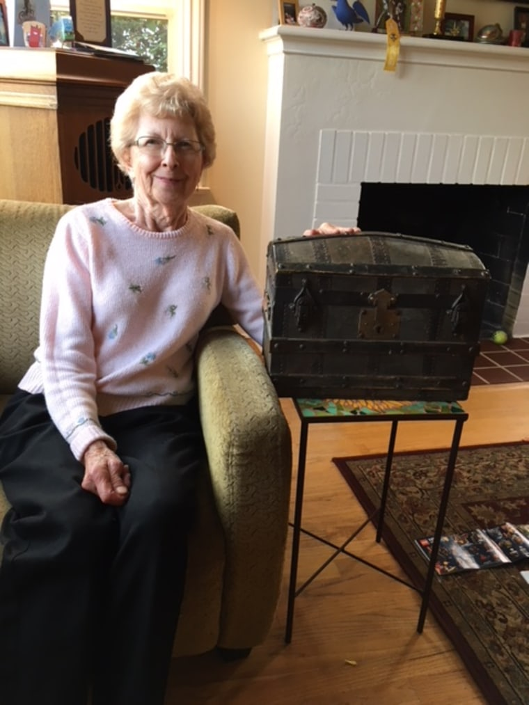 """Linda Dahlstrom Anderson's mother, Beth Dahlstrom, 88, with her own mother's trunk. """"When she was little, she and my grandmother used to look through it together on lazy afternoons,"""" says Linda."""