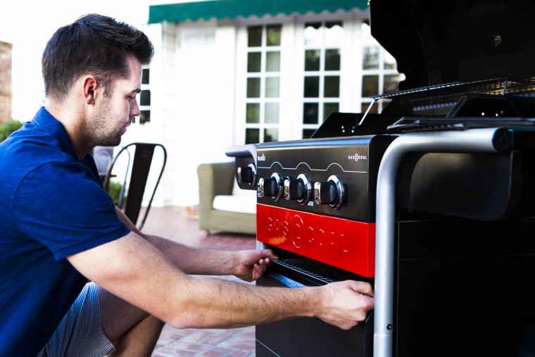 turning on a gas grill