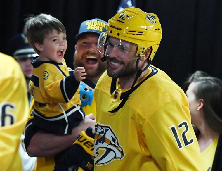 Mike Fisher kisses his son Isaiah at Predators playoff game