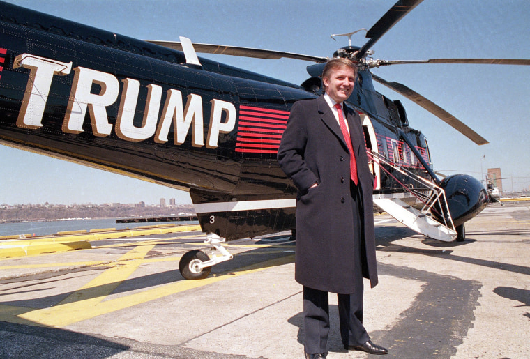 Image: Real estate magnate Donald Trump poses in front of one of three Sikorsky helicopters