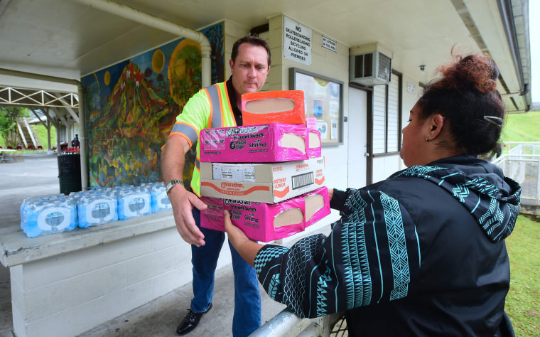 Image: Maurice Messina from the Parks and Recreation Department receives supplies donated to evacuees