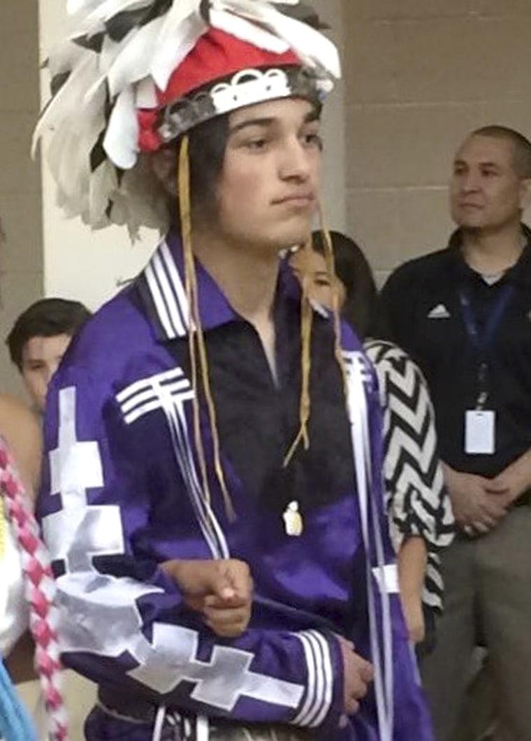 Thomas Kanewakeron Gray walks in a procession during his high school graduation at Santa Fe Indian School in Santa Fe, New Mexico, on May 26, 2016.