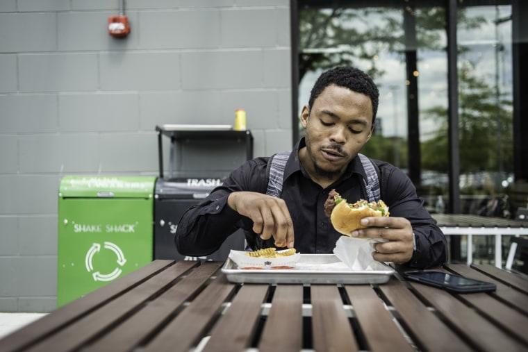 Image: Shadrack Mawolo grabs a burger at a Shake Shack