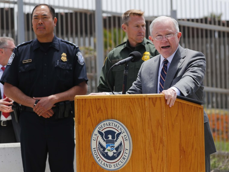 Image: U.S. Attorney General Jeff Sessions speaks during a visit to the U.S. Mexico border wall for a press conference with Immigration and Customs Enforcement Deputy Director Thomas D. Homan near San Diego