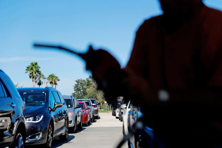 Drivers wait in line for gas in Miromar Lakes, Florida.