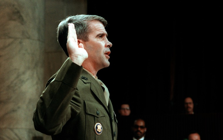 Image: Oliver North is sworn before the House and Senate Foreign Affairs Committee hearing on arms sales to Iran